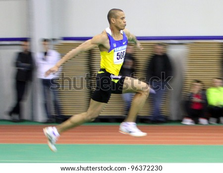 SUMY, UKRAINE - FEB.18: El-Sheryf Sheryf wins the triple jump with the result 16.81 on the Ukrainian Track and Field Championships on February 18, 2012 in Sumy, Ukraine.