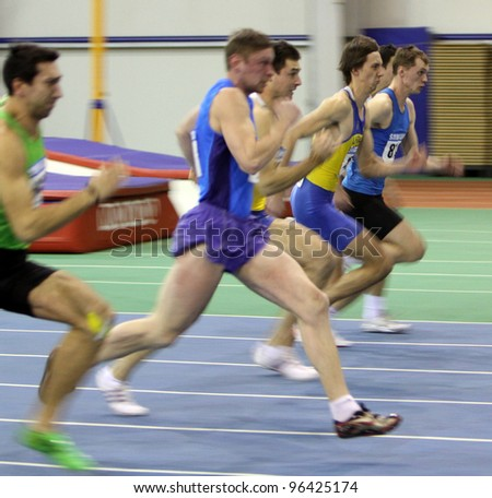 SUMY, UKRAINE - FEB.18: (L-R) Kasianov Aleksei, Shagov Aleks, Kopanaiko Sergi, Shamatrin Artem, Shuliak Andri complete in the Ukrainian Track and Field Championships on February 18, 2012 in Sumy, Ukraine. - stock photo