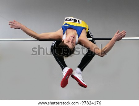 SUMY, UKRAINE - FEB.17: Sayevych Anton competes in the high jump competition during the Ukrainian Track and Field Championships on February 17, 2012 in Sumy, Ukraine. - stock photo