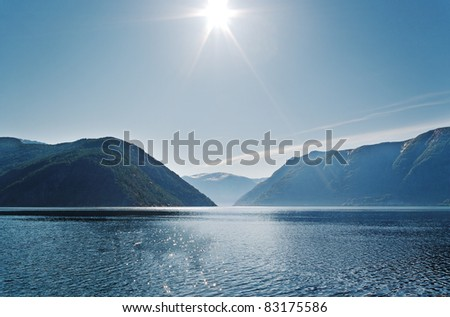 Sun above mountains, fjord in the Norway. - stock photo