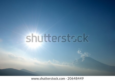 Sun and cloud and Mt. Fuji - stock photo