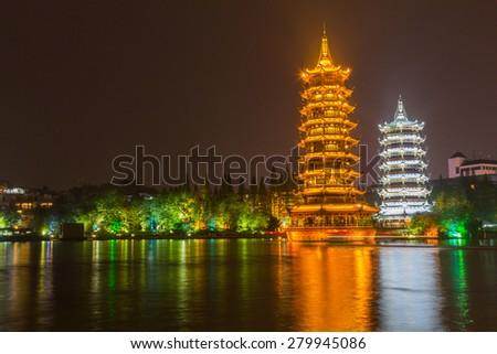 Sun and Moon Twin Pagodas at night in Guilin, China - stock photo