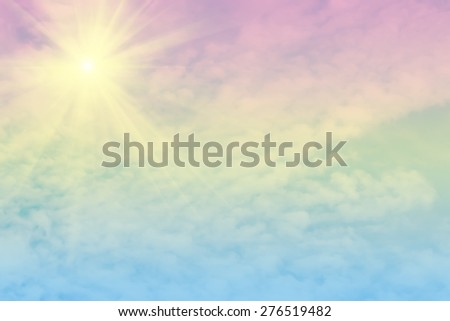 Sun beam and soft cloud background with a pastel colored orange to blue gradient. - stock photo