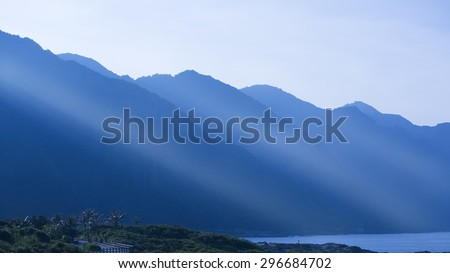 sun bean over the blue mountain in sunset,east Taiwan area,china - stock photo