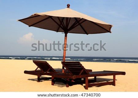 sun chairs with umbrella - stock photo