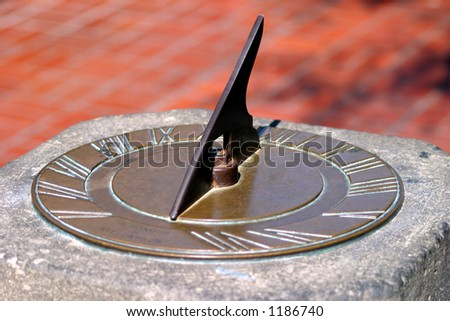 Sun dial clock - stock photo