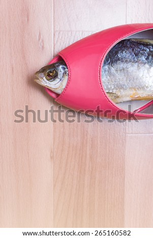Sun-dried fish within female shoe