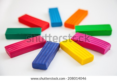 Sun from colorful plasticine on white background - stock photo