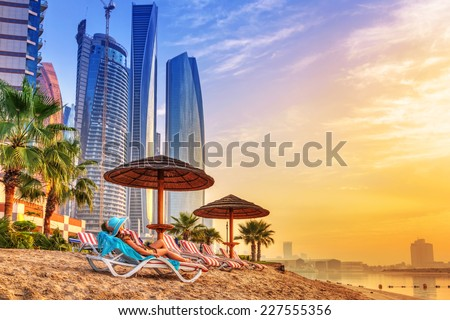 Sun holidays on the beach of Persian Gulf at sunrise - stock photo