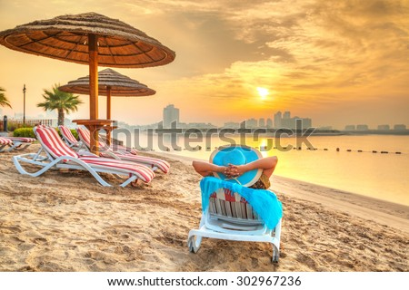 Sun holidays on the beach of Persian Gulf, United Arab Eirates - stock photo