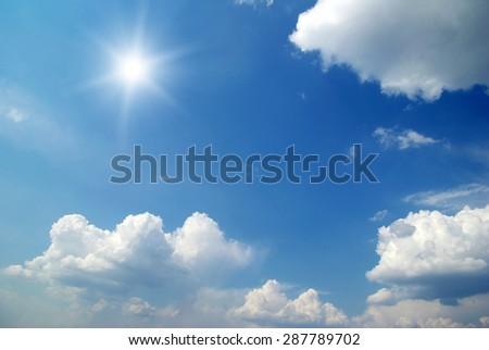 Sun in blue sky. - stock photo