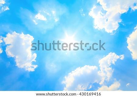 Sun in bright blue sky - stock photo