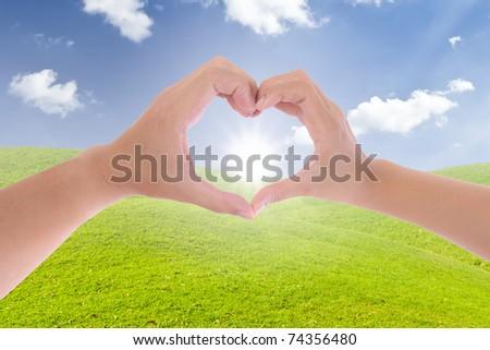 sun in hand made heart - stock photo