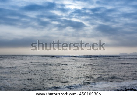 sun in the clouds over the Pacific Ocean - stock photo