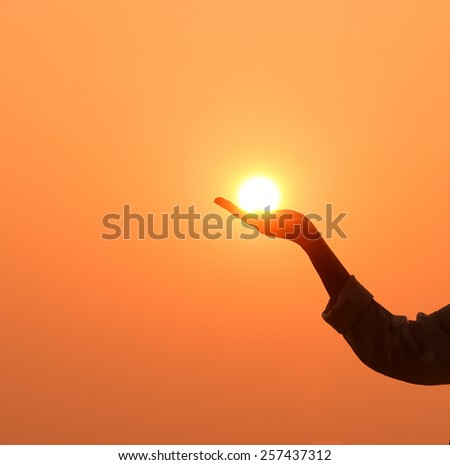 Sun in the hand on the sky - stock photo