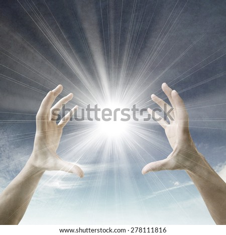 Sun in the hands - stock photo