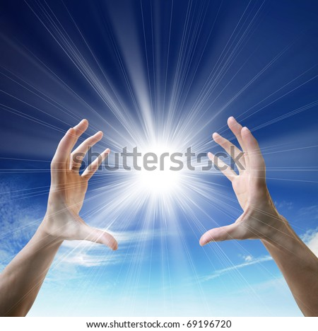 Sun in the hands on the blue sky. Freedom, harmony, spirituality concept - stock photo