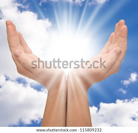 sun in the hands with copy-space - stock photo