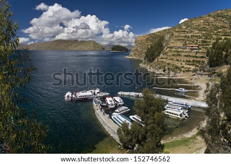 Sun Island (Isla de Sol) on Lake Titicaca in Bolivia with the Isla de Luna (Moon Island) in the distance - stock photo