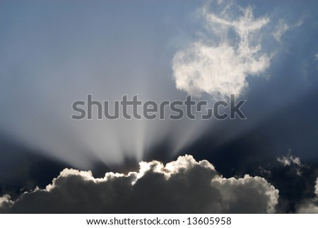 Sun light over the cloud and lighting the sky - stock photo