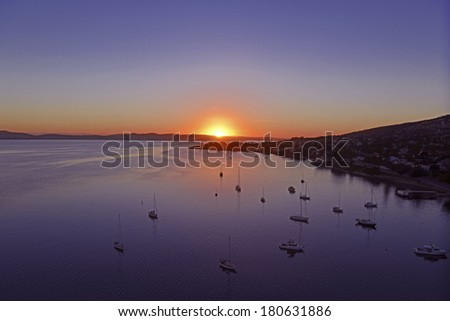 Sun lighting up Harbour in Hobart, Tasmania, Australia - stock photo
