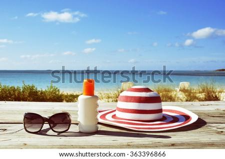 Sun lotion and sunglasses - stock photo