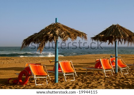 Sun loungers and beach umbrella