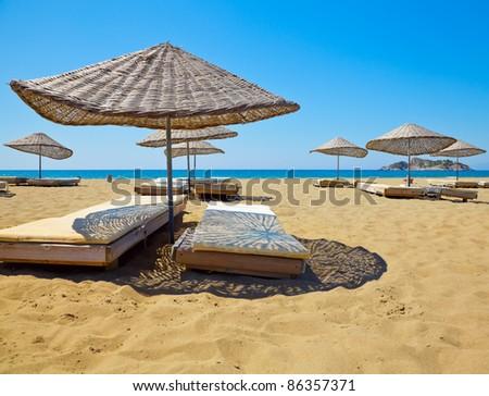 Sun loungers on a beach in Turkey - stock photo