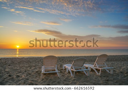 Sun loungers on sand in Ruegen island at sunrise, Germany