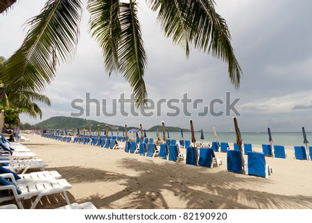 Sun lounges set up for tourists on Pa tong beach, Phuket , Thailand - stock photo