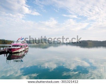 SUN MOON LAKE,TAIWAN - JUNE 7: many boats parking at the pier on June 7, 2015 at Sun Moon Lake, Taiwan. Sun Moon Lake is the largest body of water in Taiwan as well as a tourist attraction.