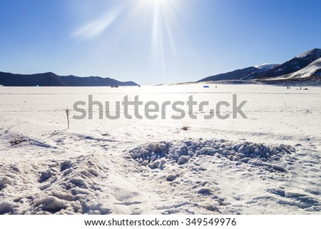 Sun over landscape in the mountains - stock photo