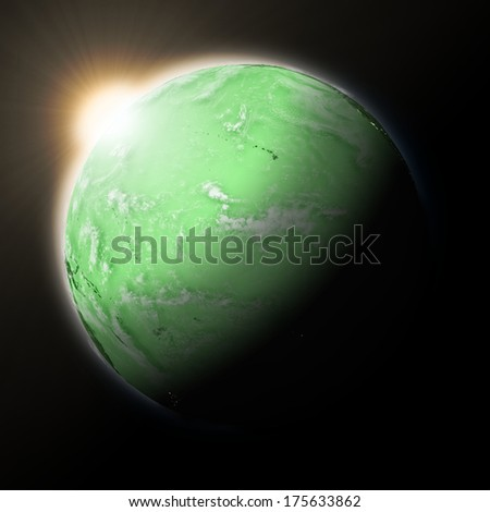 Sun over Pacific Ocean on green planet Earth isolated on black background. Highly detailed planet surface. Elements of this image furnished by NASA.