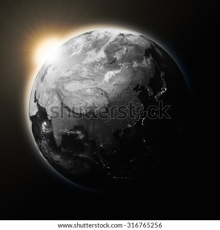 Sun over Southeast Asia on dark planet Earth isolated on black background. Highly detailed planet surface. Elements of this image furnished by NASA.