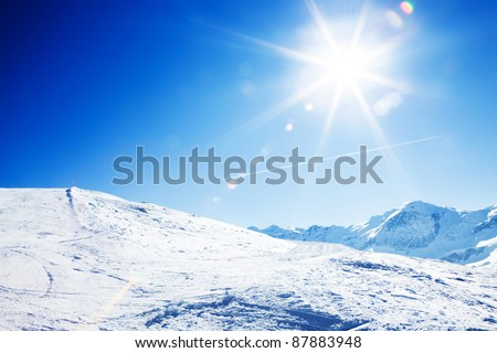 Sun over winter mountains, covered with snow - stock photo