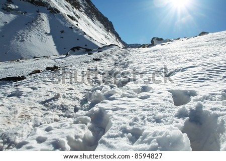 Sun picture on snow - stock photo
