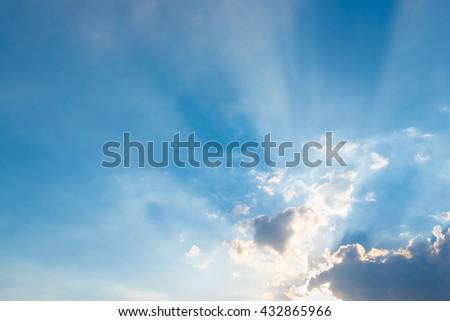 sun ray dark cloud and blue sky - stock photo