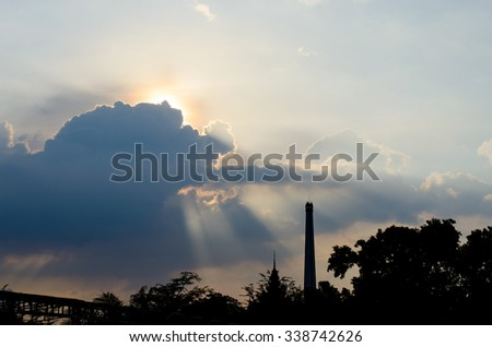 Sun ray from behind cloud in blue sky.silhouette