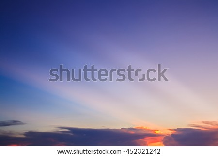 Sun ray with orange clouds and blue sky background
