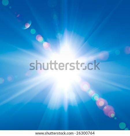 Sun rays against a blue sky - stock photo