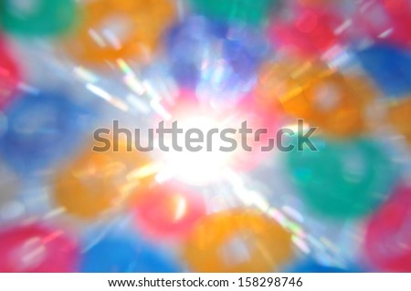 Sun rays and color circles abstract blur. Painted glass lens flare reflections. - stock photo
