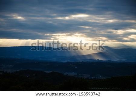 Sun Rays Through Clouds Mountains Sun rays breaking through the