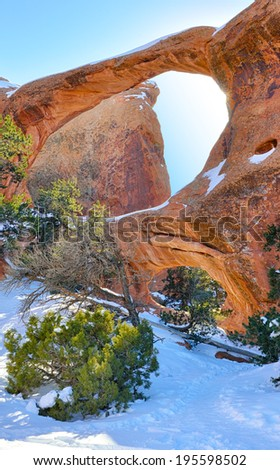 Sun rays coming through the Double-O-Arch in Devil's Garden in Arches National Park, Utah in winter, HDR - stock photo