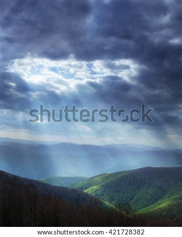 Sun rays shining through stormy clouds