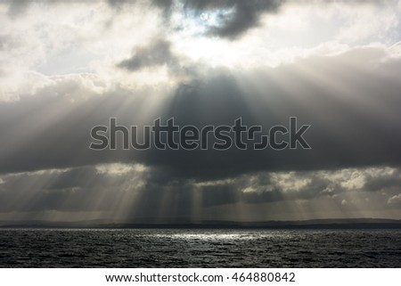 sun rays streaming through the storm clouds on the Irish Ocean