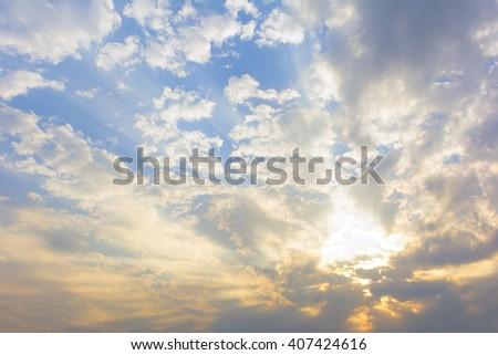 sun rays through clouds - stock photo