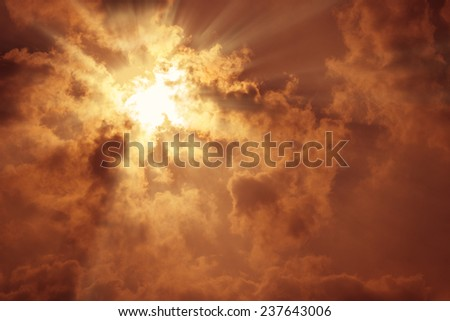 sun rays with dark clouds