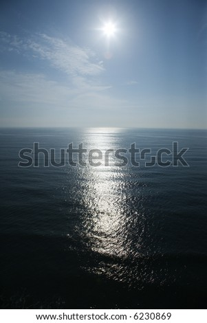 Sun reflecting in ocean. - stock photo