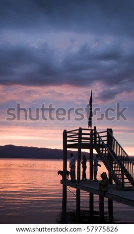 Sun Reflecting on pier iat Falthead Lake Montana - stock photo