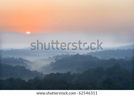 sun rise over a fog and mountain